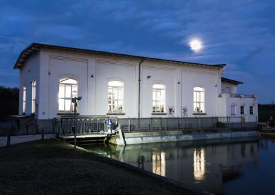 iluminated Hydro Power Plant with full moon
